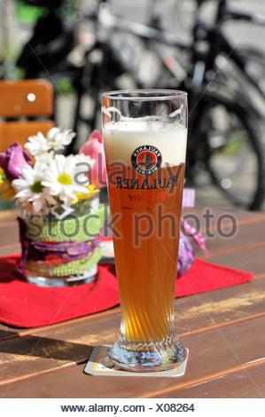 Paulaner Weissbier, wheat beer from the Paulaner brewery, beer garden, Steinhausen, Baden-Wuerttemberg - Stock Photo