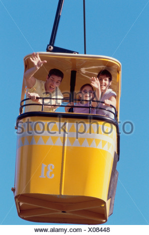 Low angle view of parents and their daughter in a cable car - Stock Photo