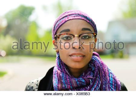 Young woman wearing headscarf - Stock Photo