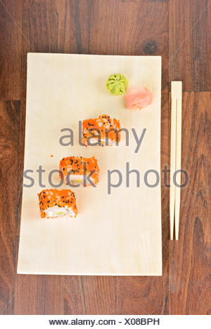Sushi rolls on the wooden plate. Top view. - Stock Photo
