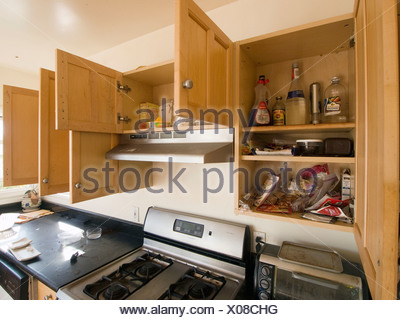 Some packaged foods and products remain in the cabinets of a kitchen inside a foreclosed home in Oakland, California, Uniited - Stock Photo