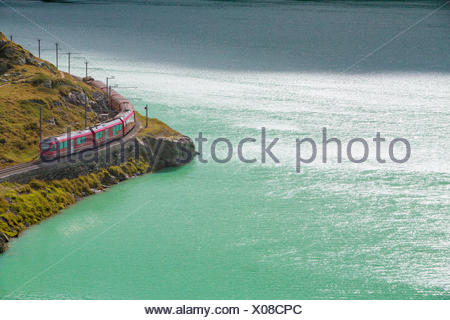 RhB in Lago Bianco in Bernina Pass in Engadin, - Stock Photo