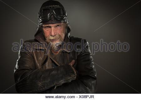 grim-looking biker - Stock Photo