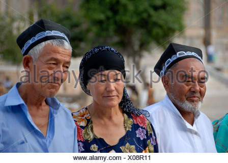Uzbeks dressed in traditional cloth Samarkand Uzbekistan - Stock Photo