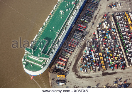 Auto transporter being unloaded - Stock Photo