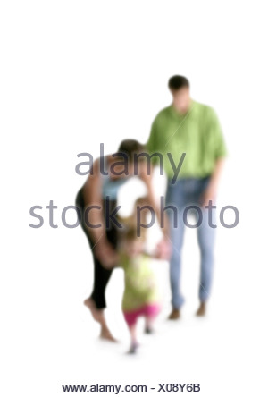 Silhouette of parents with children, on white background, defocused - Stock Photo