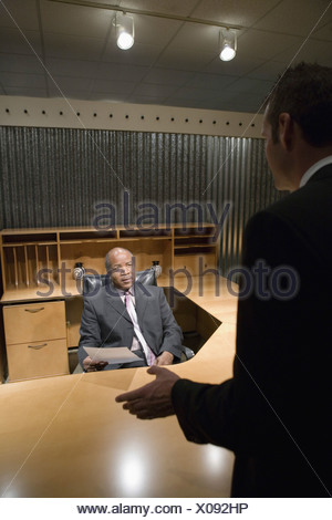 Two businessmen in an office having discussion - Stock Photo