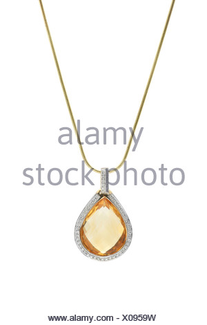 Pendant with large citrine gemstone framed with diamonds at gold necklace in front of white background - Stock Photo