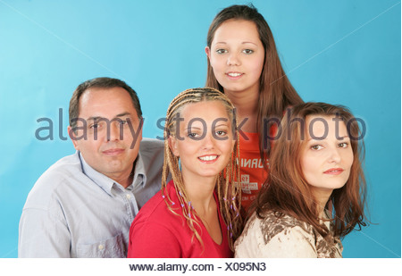 Portrait ethnic family look at camera and smile - Stock Photo