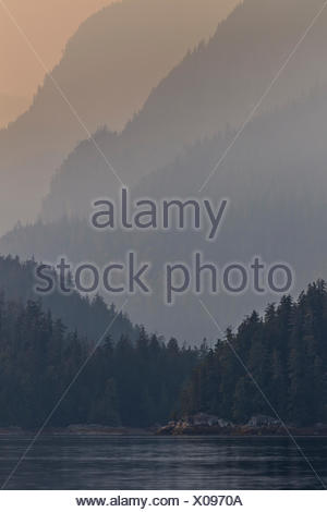 Heavy smoke from wildlifes sink into the Broughton Archipelago Provincial Marine Park near the Mainland of British Columbia, Canada. - Stock Photo