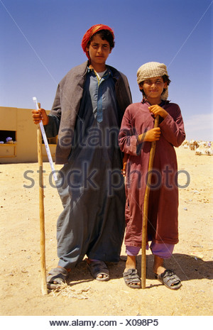 Camel shepherds, Bedouins in traditional dress, Egyptians, portrait, Dschjellahba, Jelleba, clothes, Arabian, Egyptian, Dschell - Stock Photo