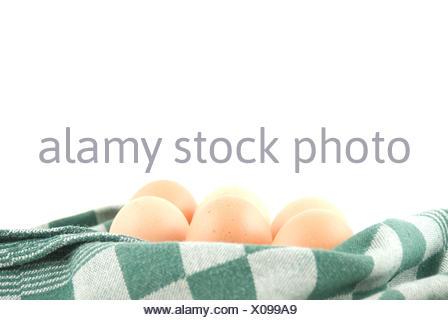 eggs in a wicker basket - Stock Photo