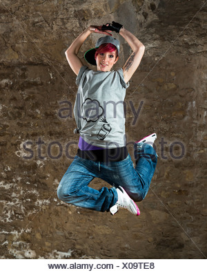 Young woman hip hop dancers dancing - Stock Photo