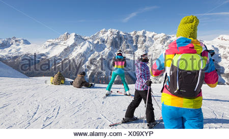 a view of a group of skiers in the Folgarida ski resort with Brenta Group in the background, Trento province, Trentino Alto Adige, Italy, Europe - Stock Photo