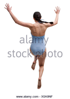 Woman diving off dock - Stock Photo