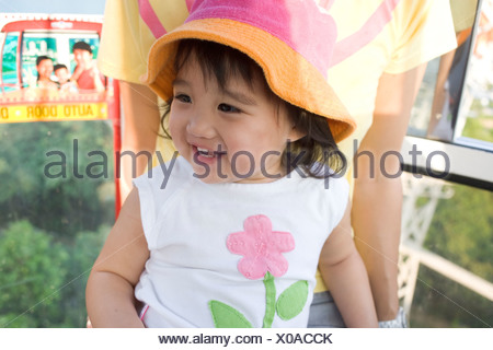Young girl with mom in cable car. - Stock Photo