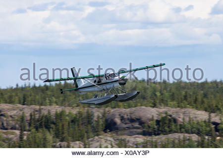 A Beaver floatplane takes off from Yellowknife, Northwest Territories, Canada - Stock Photo