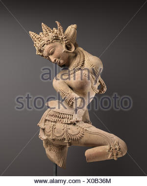 Dancing Celestial Deity (Devata). Date: early 12th century; Culture: India (Uttar Pradesh); Medium: Sandstone; Dimensions: H. 33 1/2 in. (85.1 cm); - Stock Photo