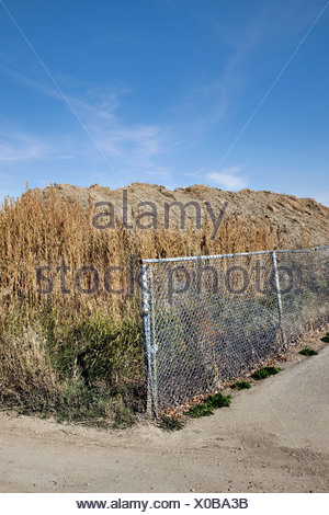 Fence next to a field - Stock Photo