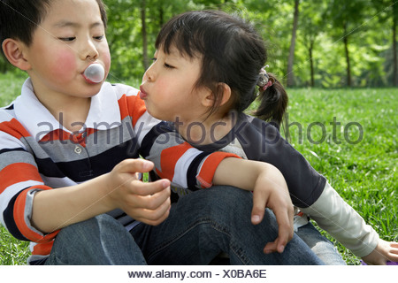 Children Playing Together In The Park - Stock Photo