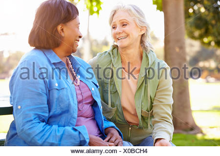 Two Senior Women Talking Outdoors Together - Stock Photo