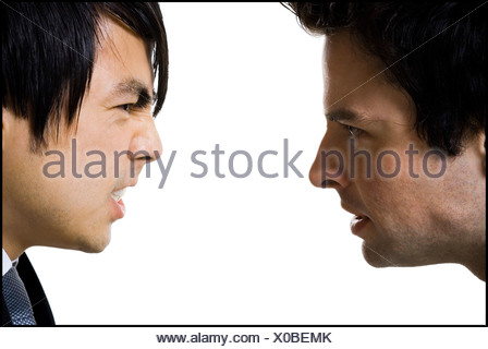 Two businessment arguing with each other - Stock Photo