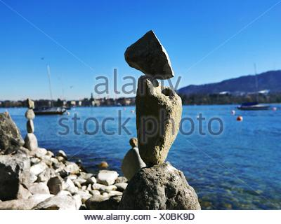 Close-Up Of Stone Pile With Sea In Background - Stock Photo