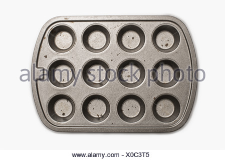 A well used, seasoned baking tray. Cookware.  A cupcake or muffin tin. - Stock Photo