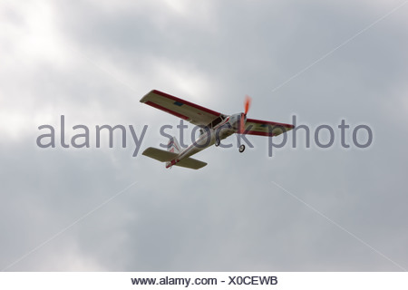 RC model airplane flying in the sky - Stock Photo
