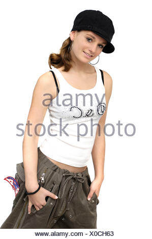 young woman with black cap and white top - Stock Photo
