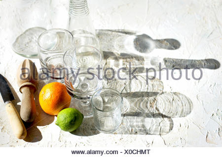 Blood Orange Lime Spritzer. Photographed on a white plaster background. - Stock Photo