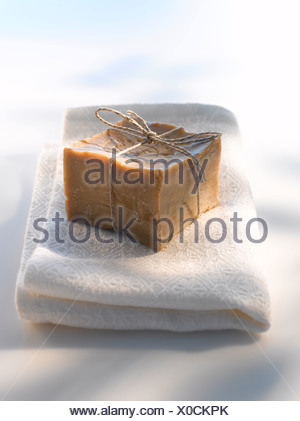Olive soap on towel, close up - Stock Photo