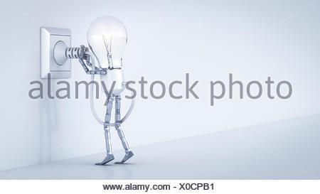 Electric bulb manikin putting plug in socket - Stock Photo
