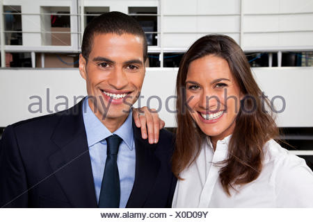 Portrait of businesswoman and businessman in the office - Stock Photo