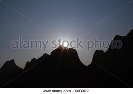The karst mountains at sunset in the countryside near Yangshuo. - Stock Photo