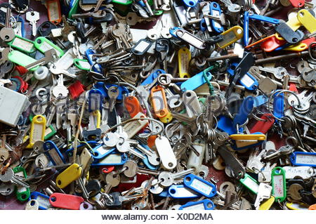 Many old keys all in a tumble - Stock Photo