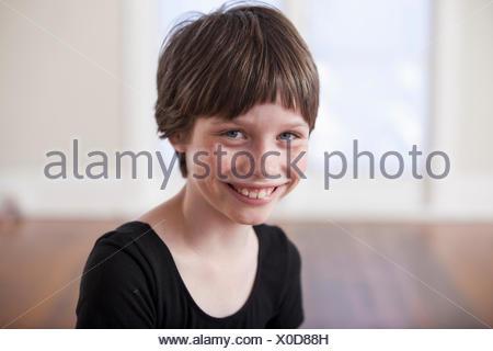 Portrait of smiling girl in ballet school - Stock Photo