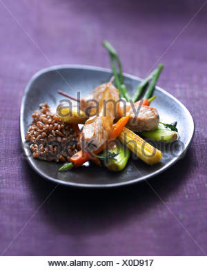 Veal saddle savory brochettes,stewed spelt and glazed mini vegetables - Stock Photo
