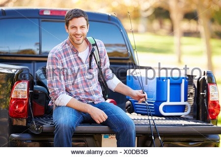 Man Sitting In Pick Up Truck On Camping Holiday - Stock Photo