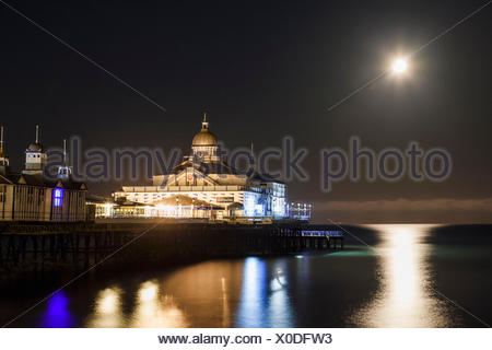 England, East Sussex, Eastbourne, Eastbourne Pier in the Moonlight - Stock Photo