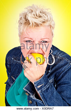 Portrait of middelaged beautiful woman eating fres - Stock Photo