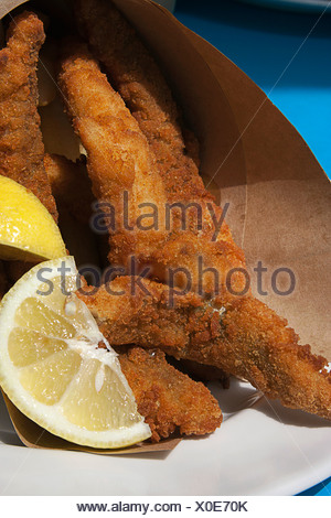 Australia, Tasmania, Hobart, Franklin Wharf, fish and chips wrapped in brown paper - Stock Photo