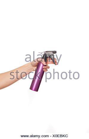 Female hand holding a spray can - Stock Photo