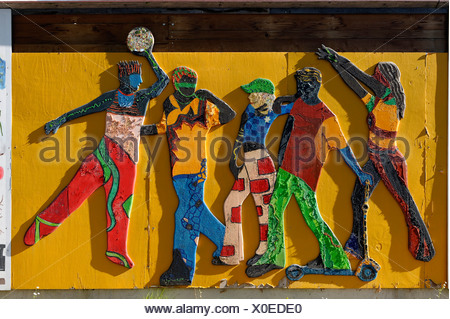 Above the Clouds, relief from 2003 created by disabled and non disabled children on the fence of the Annahuette, Anna Iron Works - Stock Photo