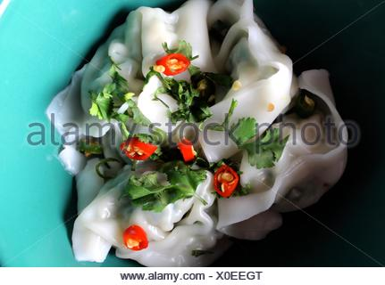 High Angle View Of Chinese Dumplings In Bowl On Table - Stock Photo
