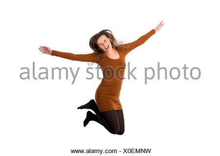 young woman jumping for joy - Stock Photo
