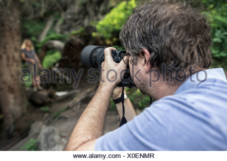 Photographer and model during a photo shoot in the woods, Stubai Valley, Tyrol, Austria, Europe - Stock Photo