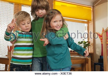 Germany, Children in nursery playing together, smiling, portrait - Stock Photo