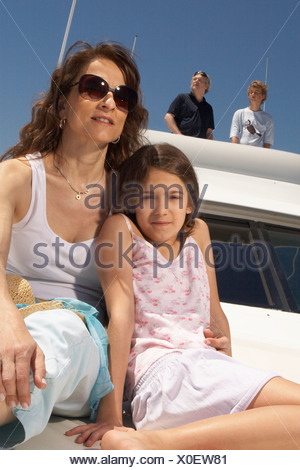Young family relaxing on boat - Stock Photo