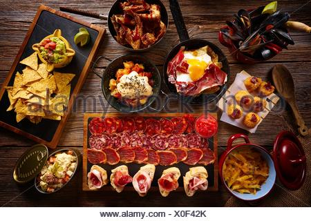 Tapas from Spain varied mix of Mediterranean food recipes. - Stock Photo